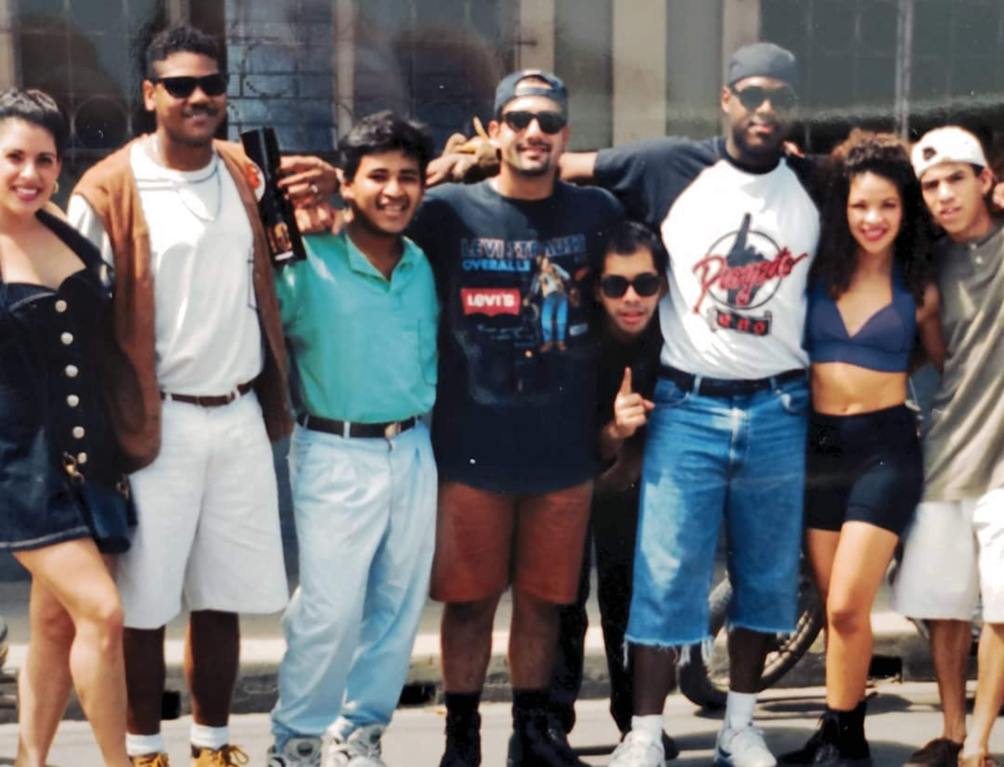 Proyecto Uno with team members, including Porfirio Piña, co-founder/manager, and unidentified fan, Venezuela, 1994