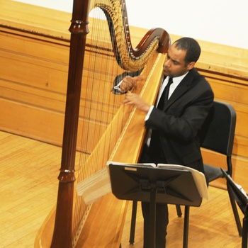 Harpist Adán Vásquez performing during Memorial Tribute Concert for Tilsia Brens on  December 17, 2010 at The City College of New York