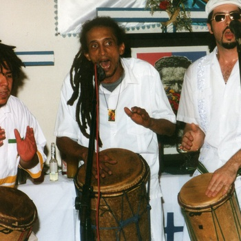 Kwesi Ernesto Rodríguez (center) of La 21 División playing at First Messianic Festival in Honor of Olivorio Mateo, June 29, 2003